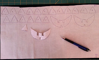 cut pumpkin face applique pieces